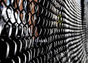 Boundaries and fences define communities. Photo by Marc Falardeau