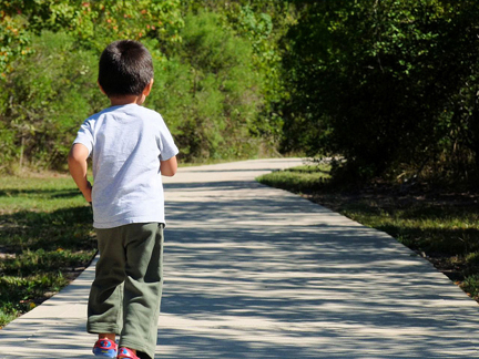 Child on park boardwalk. Photo © Richard Step, richardstep.com