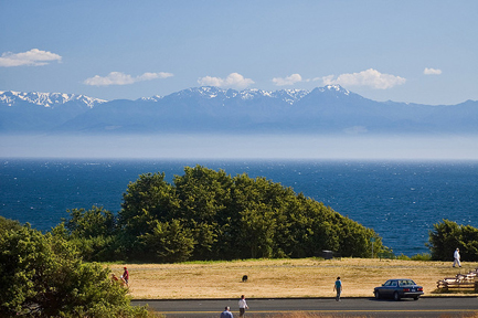 View of Olympic Range and Juan de Fuca Strait along Victoria's Dallas Road walkway. Photo © Stewart Butterfield via flickr and Creative Commons