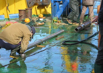 Sea-floor sediment core, on deck. Photo © NOAA Pacific Marine Environmental Laboratory