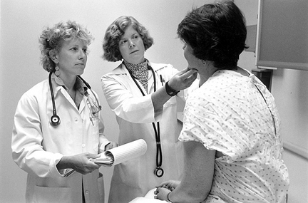 Seeing a patient. Photo © Seattle Municipal Archives